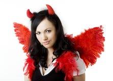Menina em um traje do diabo com um presente imagens de stock