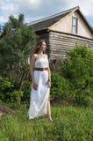 Menina em um vestido branco Imagens de Stock