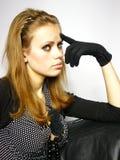 Menina em um vestido com luvas pretas Fotografia de Stock Royalty Free
