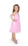 A menina em um vestido cor-de-rosa fotografia de stock