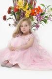 A menina em um vestido cor-de-rosa Fotos de Stock Royalty Free