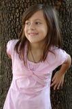 Menina em um vestido cor-de-rosa Imagens de Stock Royalty Free