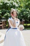 Menina em um vestido de bola, falando no telefone celular fotografia de stock royalty free