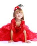 Menina em um vestido de bola vermelho Fotografia de Stock Royalty Free