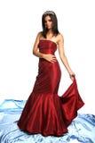 Menina em um vestido de noite vermelho e com um diadem Fotos de Stock Royalty Free