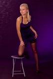 Menina em um vestido e em meias Fotografia de Stock Royalty Free
