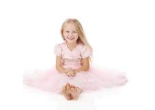Menina em um vestido elegante cor-de-rosa. Foto de Stock Royalty Free