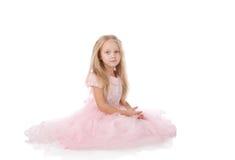 Menina em um vestido elegante cor-de-rosa Imagem de Stock