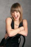 Menina em um vestido em um fundo cinzento Imagens de Stock Royalty Free