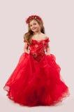 Menina em um vestido vermelho Fotografia de Stock