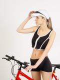 Menina em uma bicicleta Fotografia de Stock