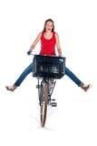 Menina em uma bicicleta Fotos de Stock
