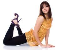 Menina em uma blusa do ouro Imagem de Stock Royalty Free