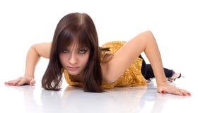 Menina em uma blusa do ouro Foto de Stock Royalty Free