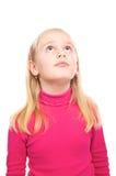 Menina em uma camisa cor-de-rosa surpreendida Fotos de Stock