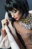 Menina em uma colar chique Foto de Stock