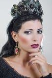 Menina em uma coroa preta Imagem de Stock Royalty Free