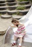 Menina em uma corrediça 01 Imagens de Stock Royalty Free