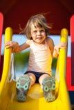 Menina em uma corrediça Fotografia de Stock Royalty Free