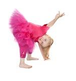 Menina em uma dança cor-de-rosa do vestido Fotos de Stock Royalty Free