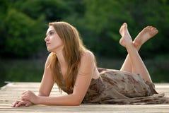 Menina em uma doca Fotografia de Stock Royalty Free