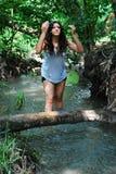 A menina em uma madeira Foto de Stock Royalty Free