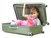 Menina em uma mala de viagem Foto de Stock Royalty Free