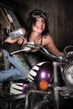 Menina em uma motocicleta Fotos de Stock Royalty Free