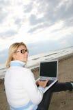 Menina em uma praia Imagens de Stock Royalty Free