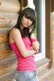 Menina em uma varanda Foto de Stock