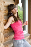 Menina em uma varanda Fotos de Stock
