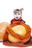Menina em uma veste alaranjada fotografia de stock