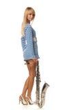 Menina em uma veste descascada com um saxofone Imagem de Stock Royalty Free