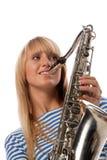 Menina em uma veste descascada com um saxofone Fotografia de Stock Royalty Free