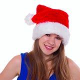 Menina emocional expressivo em um chapéu do Natal no fundo branco fotografia de stock royalty free
