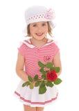 Menina encantador com a flor da rosa do vermelho Foto de Stock Royalty Free