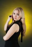 Menina encantador, isolada em um inclinação amarelo Fotografia de Stock Royalty Free