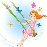 A menina encantadora em um balanço Fotos de Stock Royalty Free