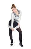 Menina encantadora em um levantamento da túnica Imagem de Stock Royalty Free