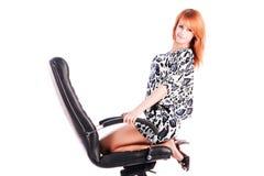 Menina encantadora em uma cadeira do escritório Foto de Stock Royalty Free
