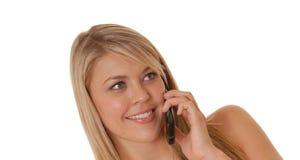 Menina encantadora no telefone de pilha fotografia de stock royalty free