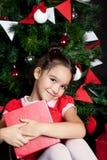 Menina encantadora no tempo do Natal Imagem de Stock Royalty Free