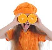 Menina engraçada com laranjas Fotografia de Stock
