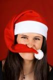 Menina engraçada de Papai Noel Fotos de Stock