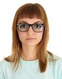 Menina engraçada em vidros muito fortes Fotografia de Stock Royalty Free