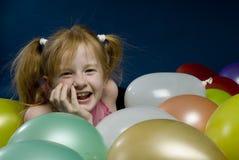 Menina entre balões Imagem de Stock