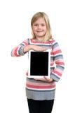 Menina ereta pequena com a tabuleta no fundo branco fotos de stock royalty free