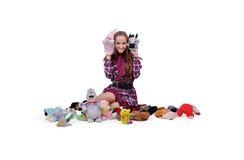 A menina escolhe um brinquedo Imagens de Stock Royalty Free
