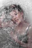 Menina escondida atrás do testes padrões translúcidos Imagem de Stock