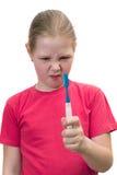 A menina escova o toothbrush dos dentes Fotografia de Stock Royalty Free